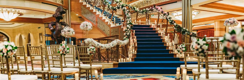 A long stairway with flower decorated bannisters leads to a large room lined with rows of chairs