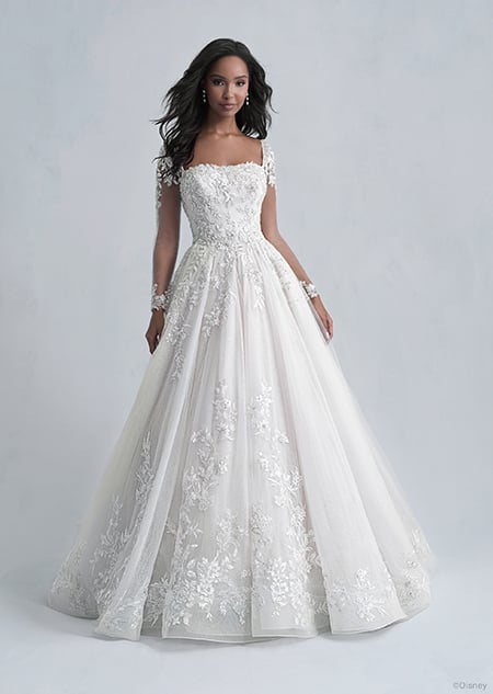 A woman wearing the Belle wedding gown from the 2021 Disney Fairy Tale Weddings Platinum Collection