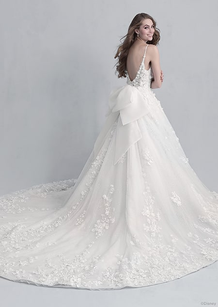 Backside view of a woman wearing the Snow White wedding gown from the 2021 Disney Fairy Tale Weddings Platinum Collection