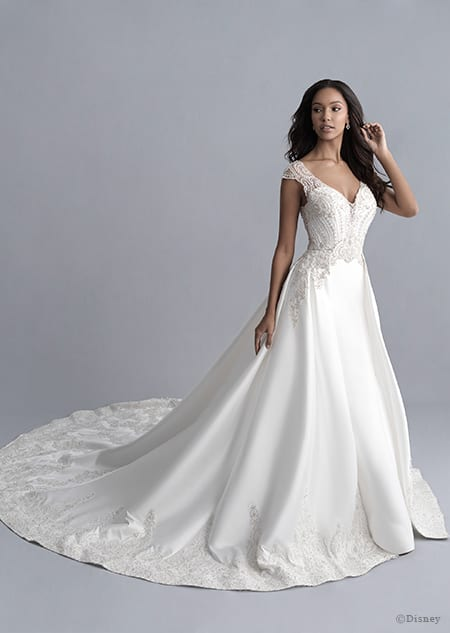 A woman wearing the Jasmine wedding gown from the 2020 Disney Fairy Tale Weddings Platinum Collection