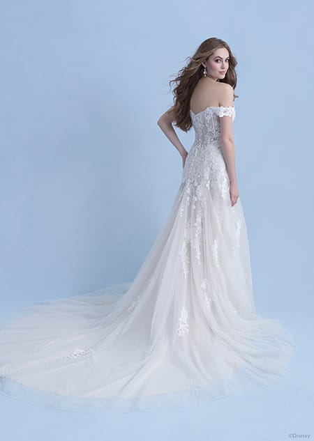 A back side view of a woman in the Aurora wedding gown from the 2021 Disney Fairy Tale Weddings Collection