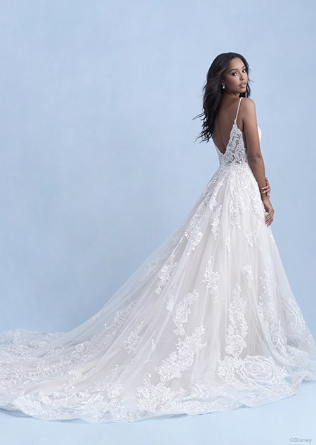 A back side view of a woman wearing the Belle wedding gown from the 2021 Disney Fairy Tale Weddings Collection