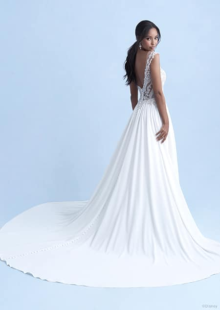 A back side view of a woman wearing the Jasmine wedding gown from the 2021 Disney Fairy Tale Weddings Collection