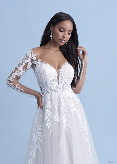 A woman in the Pocahontas wedding gown from the 2021 Disney Fairy Tale Weddings Collection