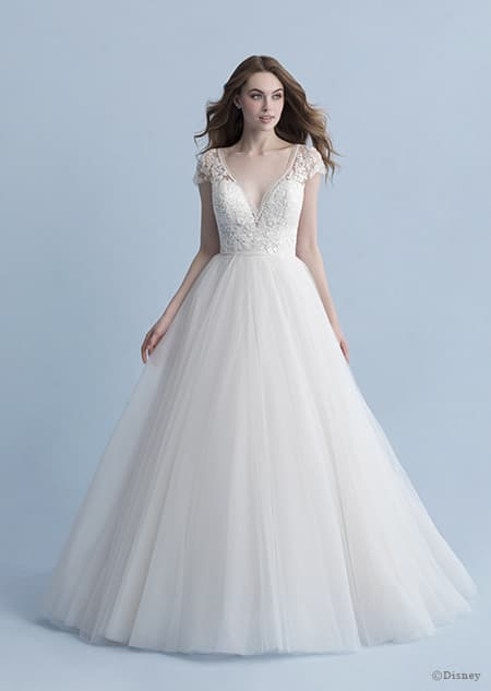 A woman wearing the Cinderella wedding gown from the 2020 Disney Fairy Tale Weddings Collection