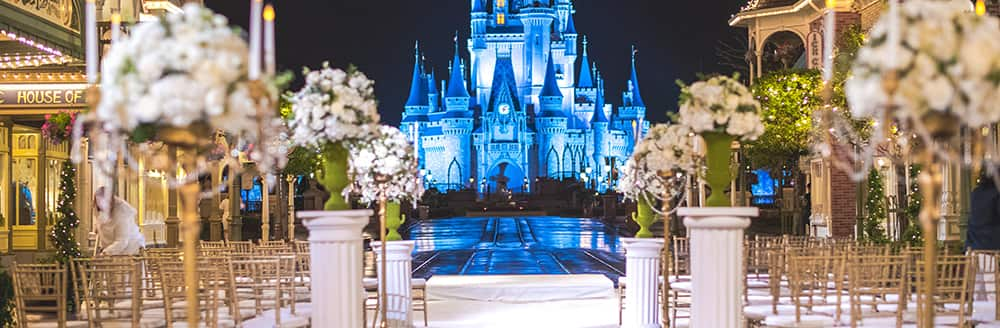Rows Of Chairs And Flowers Arranged For A Wedding Ceremony With Castle As The Backdrop