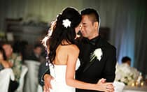 A bride and groom dance in front of their guests