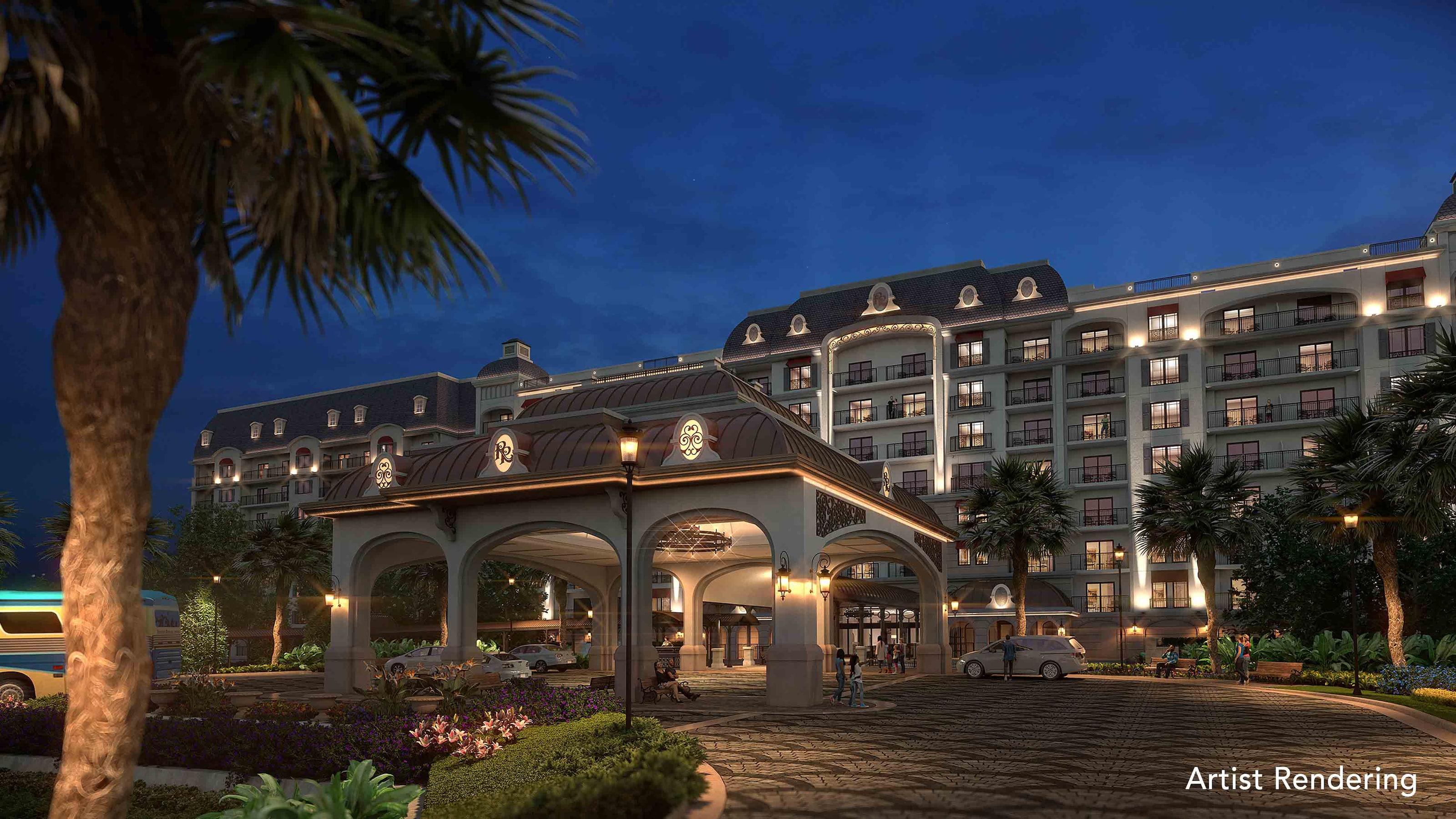 The entrance and porte cochere of Disney's Riviera Resort, illuminated at night