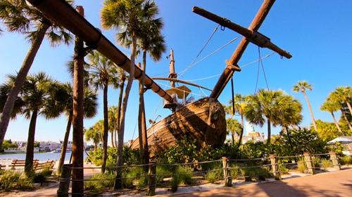 A Life Sized Shipwreck On Beach By Lake