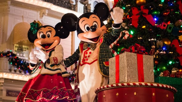mickey and minnie mouse dressed in holiday attire standing beside a christmas tree and presents - Mickeys Christmas