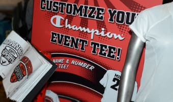 A sign and book to customize your event t-shirt