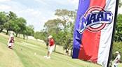 A golfer follows through on his swing