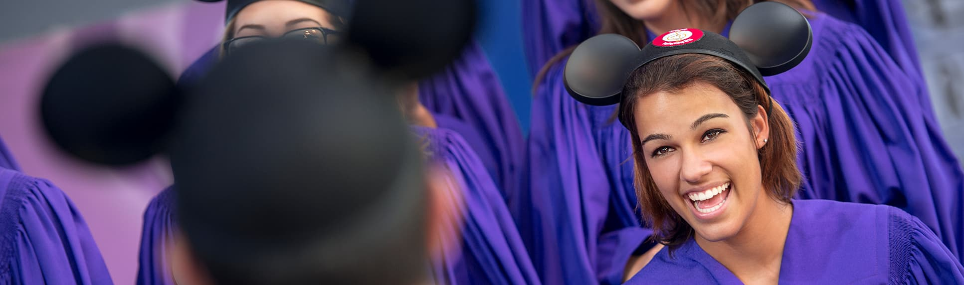 People wearing Mickey Ears sing in a choir